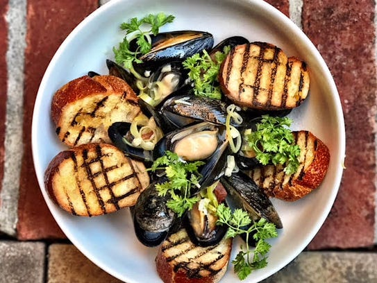 P.E.I. mussels with harissa, sherry, lemon, white wine