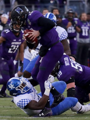 Kentucky's Joshua Paschal sacks Northwestern's Clayton Thorson.