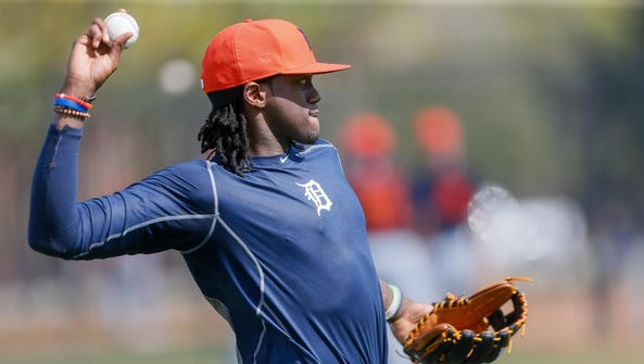Tigers center fielder Cameron Maybin warms up throwing