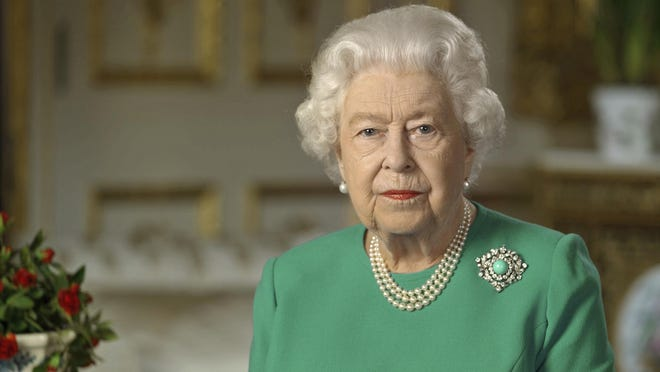 In this image taken from video and made available by Buckingham Palace, Britain's Queen Elizabeth II addresses the nation and the Commonwealth from Windsor Castle, Windsor, England, Sunday April 5, 2020. Queen Elizabeth II made a rare address, calling on Britons to rise to the challenge of the coronavirus pandemic, to exercise self-discipline in an increasingly challenging time.