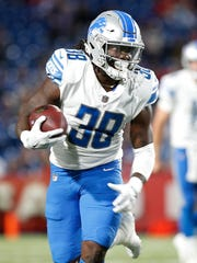 Lions running back Tion Green runs with the ball in
