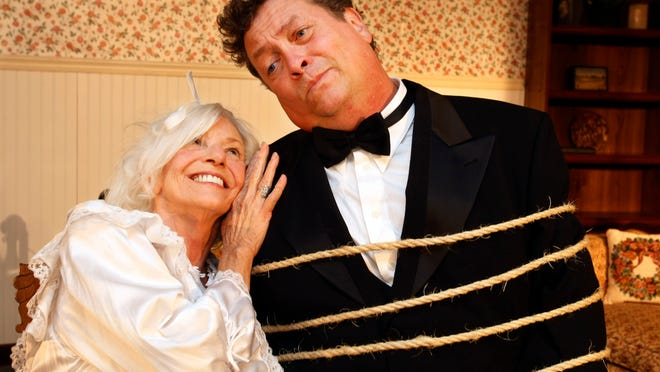"""Sally Welch cuddles next to Bill Colclough in the Cumberland Arts Center production murder mystery, """"The Butler Did It!"""""""