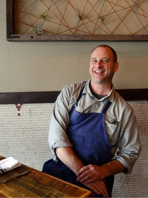 Rhubarb chef and owner John Fleer in the dining area of the restaurant.