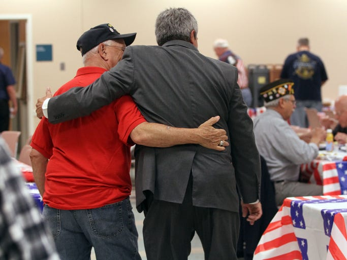 """Senator Christopher """"Kip"""" Bateman, right, puts his arm around one of the veterans attending the breakfast, as Hillsborough holds an annual breakfast at the municipal building on the Saturday before Memorial Day to honor veterans and widows of veterans, May 24, 2014. Hillsborough NJ.  BRI 0525 Honoring Veterans"""
