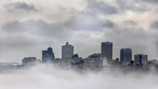 The Memphis skyline emerges as the fog burns away as viewed from the Big River Crossing.
