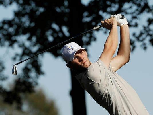 Europe's Thomas Pieters hits a shot on the 13th hole during a foresomes match at the Ryder Cup golf tournament Saturday, Oct. 1, 2016, at Hazeltine National Golf Club in Chaska, Minn. (AP Photo/David J. Phillip)