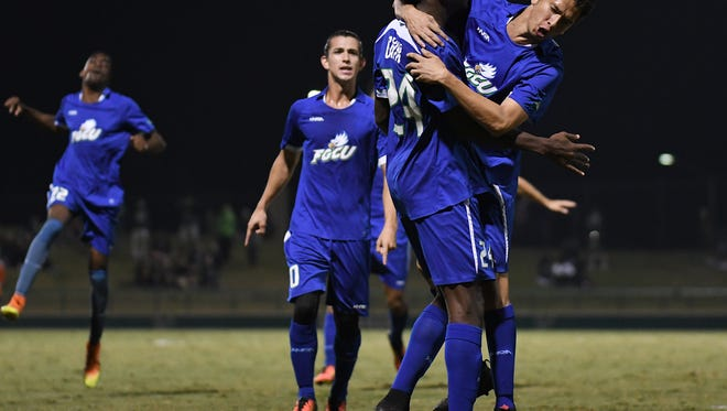 Florida Gulf Coast University midfielder Justin Galvin (24) celebrates after scoring a second half goal to tie the game 2-2 against the University of South Florida in the first round of the NCAA soccer tournament at  Corbett Stadium.