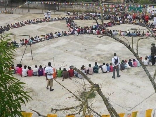 Haiti_Peace_flags_in_the_Wind_Human Peace Sign.jpg