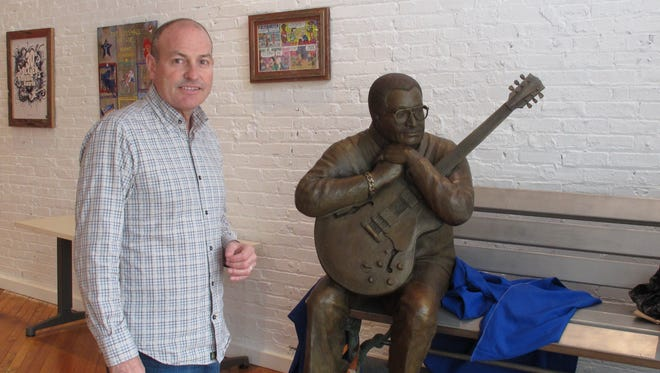 Jay Sieleman, president and CEO of The Blues Foundation stands next to a statue of blues musician Little Milton at the Blues Hall of Fame museum in Memphis, Tennessee. The foundation raised nearly $3 million for the museum, which is set to open Friday in Memphis.