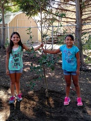 Sisters Brooklyn, 9, and Bailyn, 7, Lopez with the
