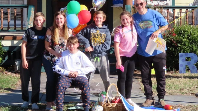 Owen Curreri (seated curbside) enjoyed a birthday parade in his honor on his 13th birthday. With him are his parents, Jennifer and Bobby Curreri, and his 10-year old triplet siblings Colin, William, and Jocelyn.