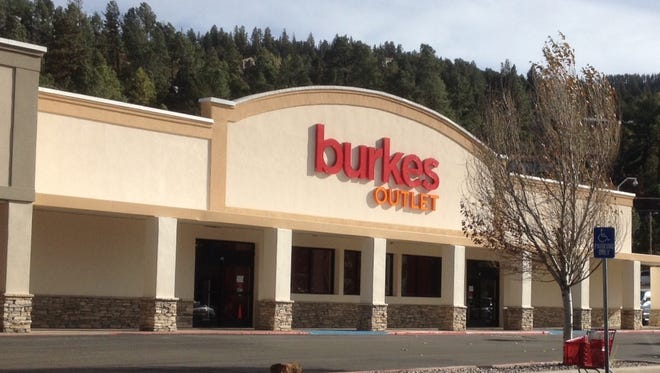 A woman tried to steal clothes from Burkes by wearing them out the door, and her male companion punched a store employee who tried to stop them.