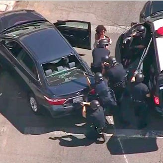 Suspect in Trader Joe's standoff arrested on murder charges; store manager, 27, died in melee