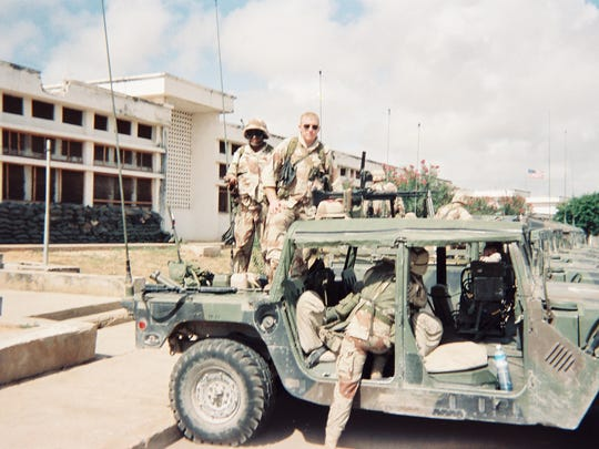 Army infantryman J.T. Cooper, center top, behind an M-60 machine gun, with troops from A Company 2-14 INF from the 10th Mountain Division in 1993 before the Battle of Mogadishu