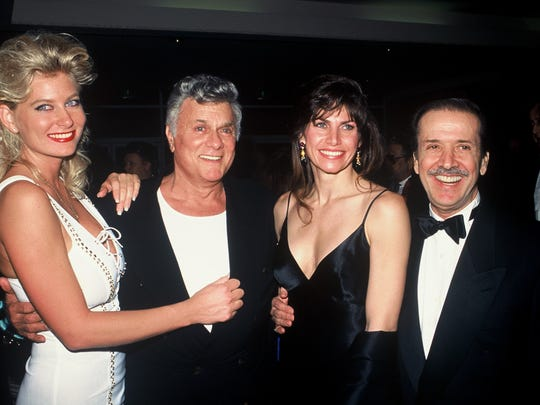 Tony Curtis, with an unidentified woman to his left, his seen with Mary and Sonny Bono at the 1995 Palm Springs International Film Festival Awards Gala.