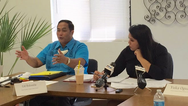Guam Academy Charter Schools Council member Frankie Toves, left, gestures as he talks Thursday Dec. 7, 2017, about Career Tech High Academy Charter School's appeal to have their charter school application considered received in February, and not August. The council, led by Amanda Blas, right, was unable to vote on any of two non-converted charter school applications Thursday because none of the motions to approve was seconded.