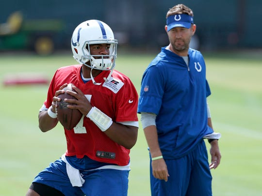 Indianapolis Colts quarterback Jacoby Brissett (7) goes through drills as quarterbacks coach Brian Schottenheimer,right, watches during their practice at the Colts complex Thursday, Sept, 14, 2017.