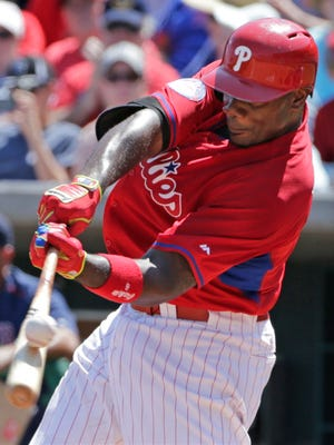 Philadelphia Phillies Ryan Howard hits the ball during a spring training baseball game against the Boston Red Sox in Clearwater, Florida, Sunday. Howard flew out to deep left field on the play.