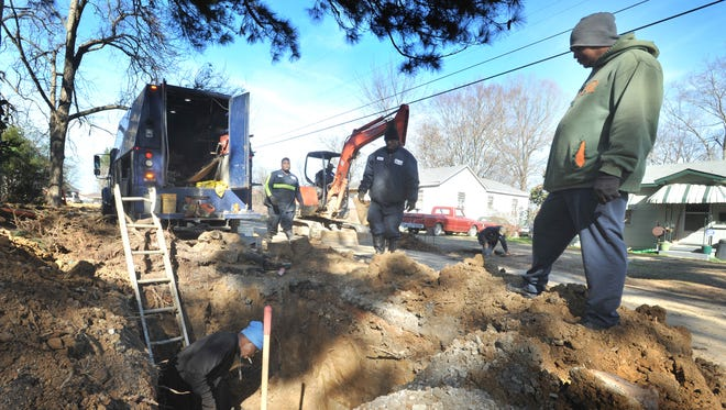 Jackson Public Works employees work to replace a water line Thursday along Fairmont Avenue in Jackson.