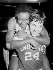 MVP Isiah Thomas and Randy Wittman celebrate after beating the University of North Carolina.