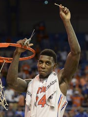 North Side grad Casey Prather cut a strand of the net after the Florida Gators beat Dayton in Memphis this past March to advance to the NCAA tournament Final Four.