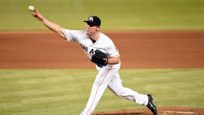 Former McCutcheon and Purdue pitcher Nick Wittgren (64) throws during the seventh inning against the Washington Nationals at Marlins Park. It was Wittgren's MLB debut.
