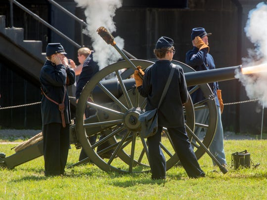 Civil War re-enactors fire a cannon Aug. 4, 2018, during a program at Fort Pickens.