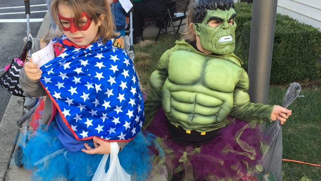 Wonder Woman Chloe Day, 7, is joined by Princess Hulk Aubree Day, 7, at Safety Village Trick or Treat.