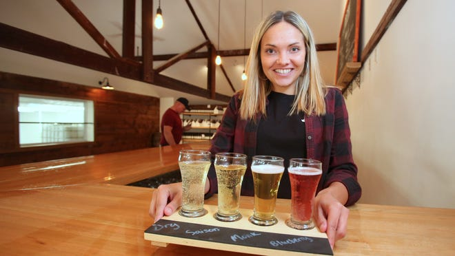 Brenna Marnell with a selection of hard ciders in the new tap room at Bad Seed Cider in Highland, N.Y.