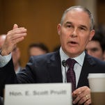 EPA nominee Pruitt contradicts Trump claim that climate change is a hoax