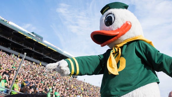 Oct 29, 2016; Eugene, OR, USA; Puddles the Oregon Ducks mascot celebrates during the first quarter against the Arizona State Sun Devils at Autzen Stadium. Mandatory Credit: Cole Elsasser-USA TODAY Sports