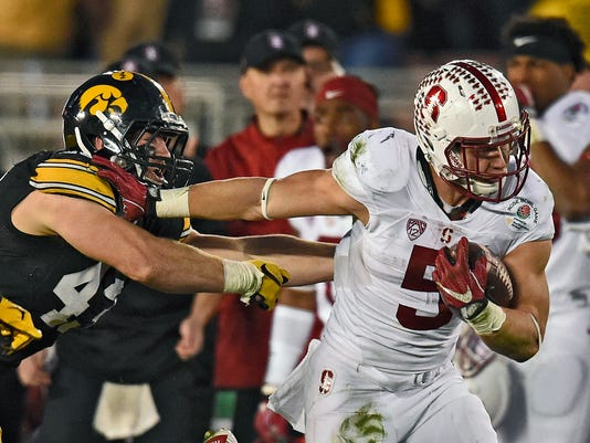 Stanford running back Christian McCaffrey, right, breaks away form Iowa linebacker Josey Jewell during the second half of the Rose Bowl NCAA college football game, Friday, Jan. 1, 2016, in Pasadena, Calif. (AP Photo/Mark J. Terrill)