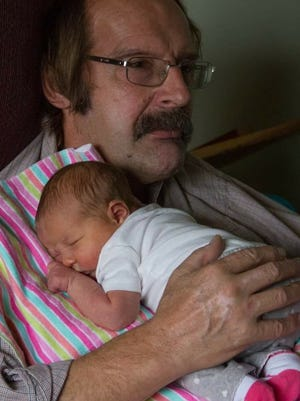 Dennis Kauffman, holding his great granddaughter, Amber on Feb. 5 the day she came home from the hospital.