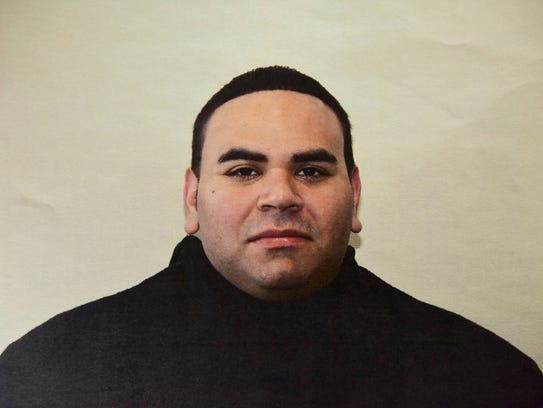Paterson police officer Jonathan Bustios is charged