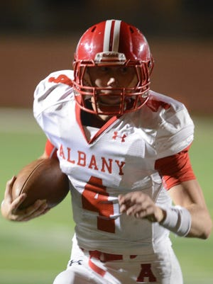 Albany quarterback Brian Hamilton runs the football during the Lions' 55-7 win over Lindsay in a Region I-2A Division II semifinal matchup Friday at Mineral Wells' Ram Stadium.