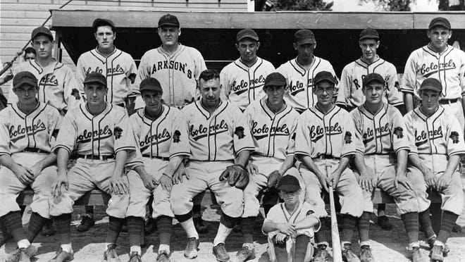 In 1937, the Canadian-American League had eight professional baseball teams - Oswego, Ogdensburg, Smith Falls, Ottawa, Brockville, Gloversville, Perth and Rome. The Rome Colonels played in a park near Coleman's Rodeo Club, near where Route 49 headed west toward the Erie Canal. In 1938, a new park was built on Black River Boulevard. The 1937 Colonels finished with a 40-58 record. Standing from left: Paul Briscoe, Jim O'Rourke, Don Miller, Manager Joe Brown, George Roholl, Hal White (a Utican who went on to pitch for the Detroit Tigers, St. Louis Browns and St. Louis Cardinals) and Peter Dashewski. Seated from left: Al Koval, Frank Buscall, Chief St. Denis, Joe Keifer, Howard Page, Scotty Bergmiller, Frank Janek and Fran Ettinger (from Rome). Seated on the ground is team mascot Douglas Wilson.