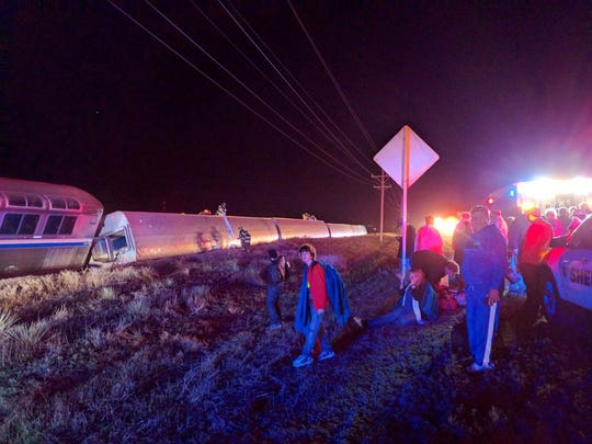 Passengers gather after a train derailed near Dodge City, Kan., Monday, March 14, 2016. An Amtrak statement says the train was traveling from Los Angeles to Chicago early Monday when it derailed just after midnight.