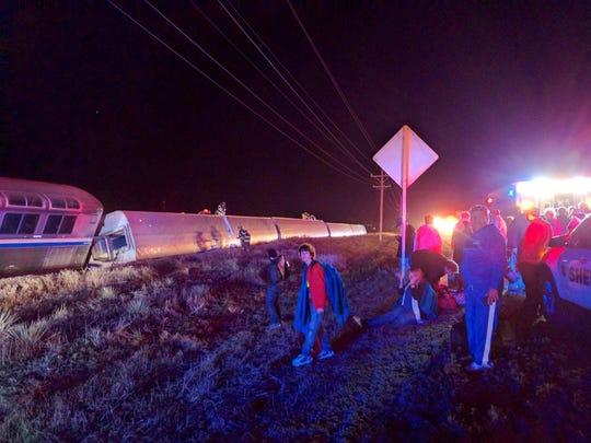 Passengers gather after a train derailed near Dodge