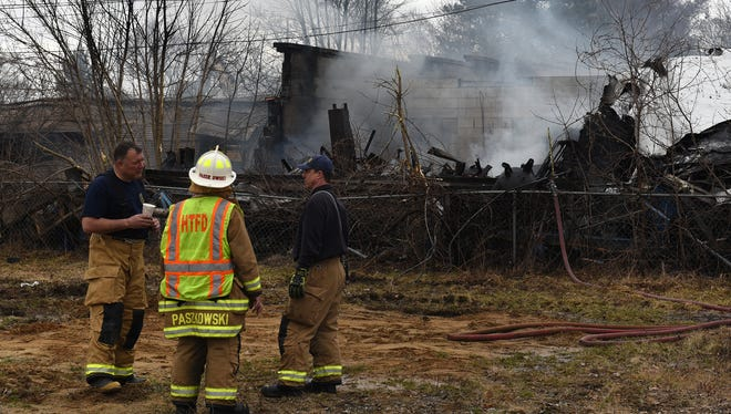 Smoke rises from Highland Auto Supply in March. Cause of the fire is considered undetermined according to a report by Oakland County fire investigators.