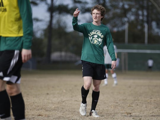 Lincoln team captain and senior defender Spencer Dennis practices with his teammates at their high school on Tuesday, Jan. 26, 2016.