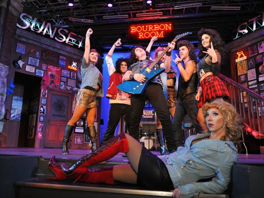 """In the foreground is Lisa-Marie Legg, as """"Sherrie,"""" with Matt Rothenberg, as """"Drew,"""" playing guitar from """"Rock of Ages"""", a sexy musical featuring numerous 1980s rock songs, that was staged at the Titusville Playhouse earlier this year. The playhouse recently received a $250,000 state grant to help pay for renovations to rehearsal space and dressing rooms."""