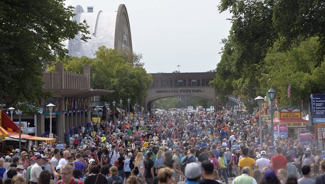 In this file photo, crowds pack the main thoroughfares of the Minnesota State Fair.