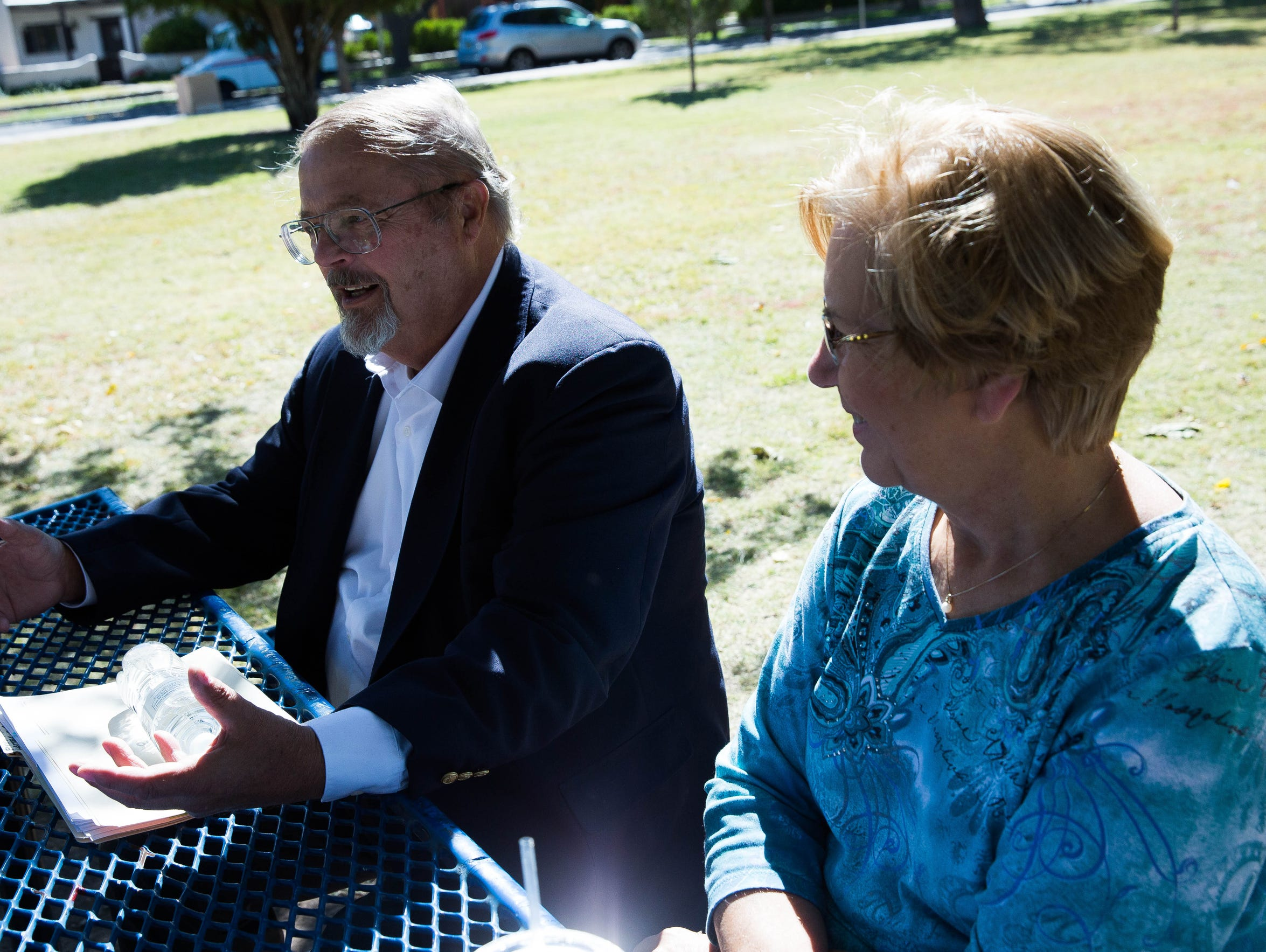 Fed Neumann, left, and his wife Kay Neumann, right, talk about what it's like to live with multiple chemical sensitivity at Pioneer Women's Park on Thursday, Nov. 2.