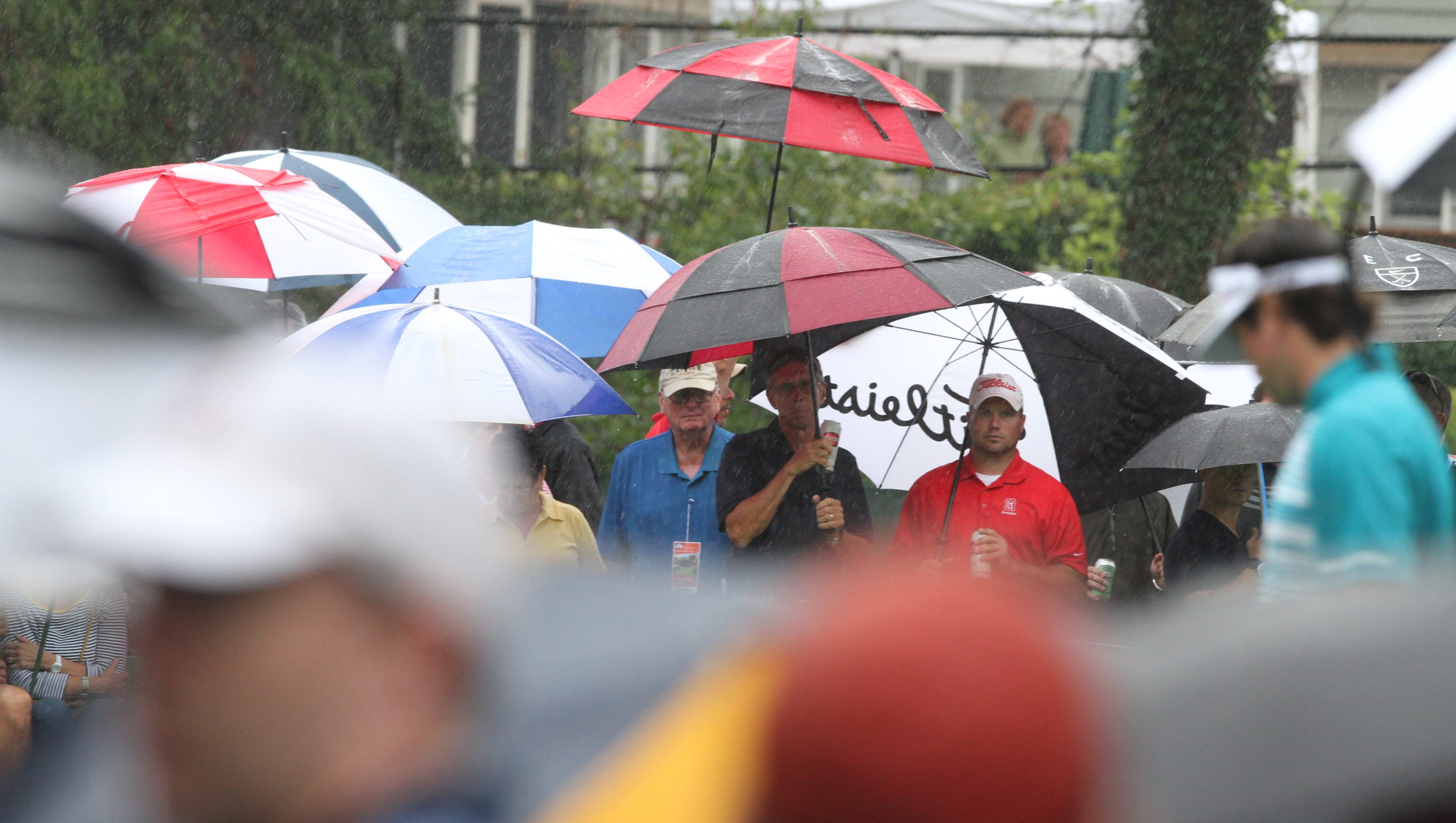 Rain does not keep fans away as some line the fairway on 2 and watch Bubba Watson during the second round at the  95th PGA Championship held at Oak HIll Country Club in Pittsford on August 9, 2013.
