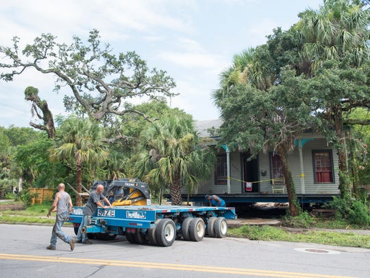 Workers from Ducky Johnson House Movers move a remote