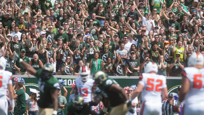 A sellout crowd of 37,583 fans celebrate a turnover forced by CSU's defense in a season-opening 58-27 win over Oregon State on Aug. 26, 2017, at the Rams' new on-campus stadium.