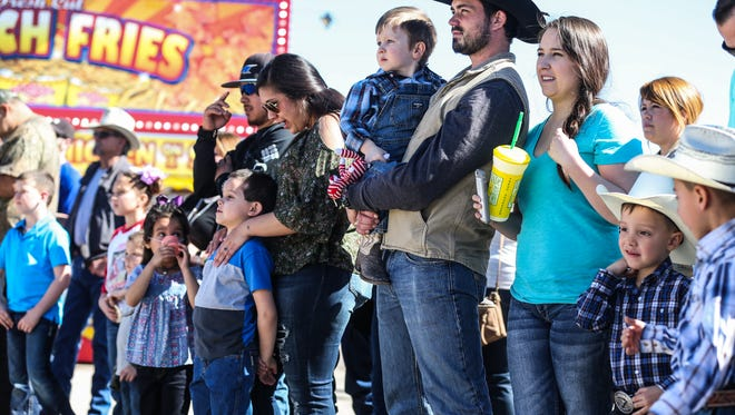 Visitors gather around for the pig races in the midway during the San Angelo Stock Show & Rodeo Sunday, Feb. 4, 2018, at the fairgrounds.