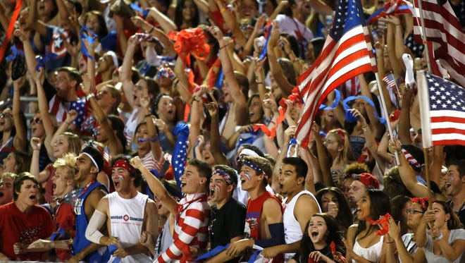 Hamilton fans cheer during  the 1st quarter of a high school football game against Mountain Pointe at Hamilton High in Chandler on September 26, 2014.