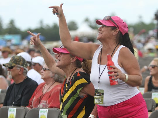 Marie Morgan and Teresa Green whoop it up while listening to The Voice Season 7 Winner Craig Wayne Boyd at Countrylife Music Festival in Punta Gorda Friday. The festival continues Saturday and Sunday.