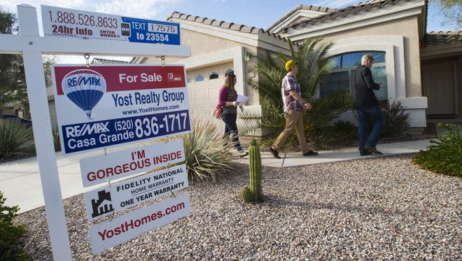 NEXT SNAPSHOT: OCT. 11 Michael Chow/The Republic Megan and Kirk Scallon follow real-estate agent John Gluch as they look for their first home on March 14 in Pinal County. Despite near-record sales and a 75 percent growth in housing prices in the Valley in 2012 and 2013, the Valley market was relatively sluggish in 2014. Megan and Kirk Scallon follow real estate agent John Gluch as they look for their first home to purchase in Casa Grande, Ariz. Tuesday March 11, 2014. Pinal county home prices rebounded more than other parts of the Valley last year.